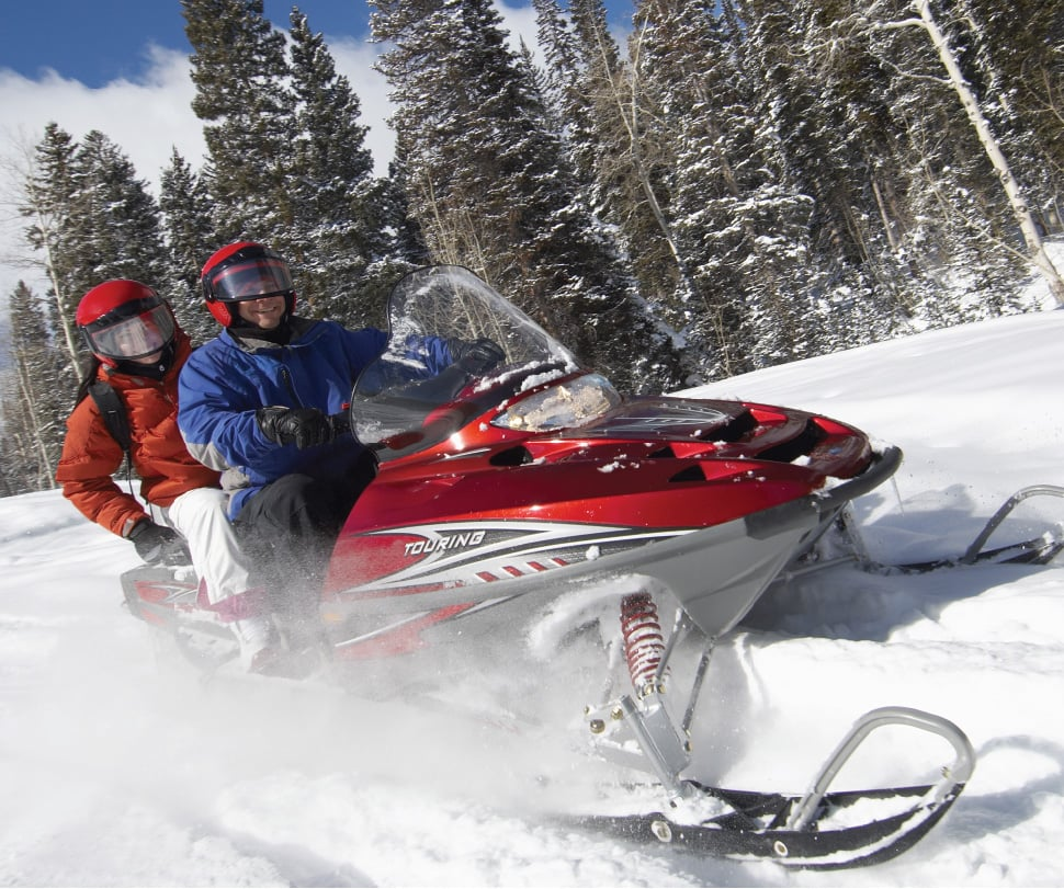 Snowmobiling people