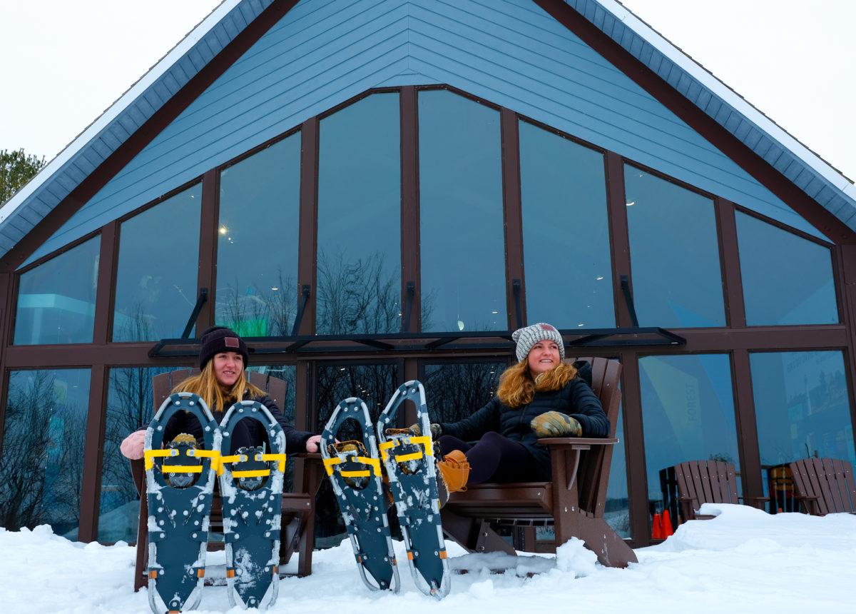 girls snowshoeing at nature center